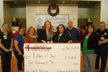Ribbons of Hope receiving giant check for grant